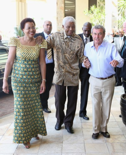 Graca Machel and Nelson Mandela greet Sol Kerzner