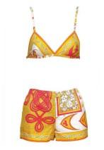 Vintage Emilio Pucci - A cotton print bikini top and boy shorts in a vibrant yellow, white and orange print