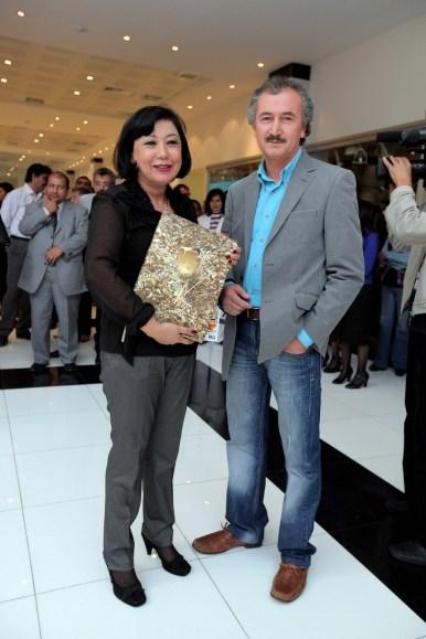 Painter Akmal Nur(R) and Elmira Ahkmedova