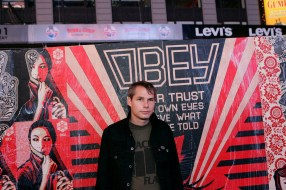 Shepard Fairey in Front of his Public Mural