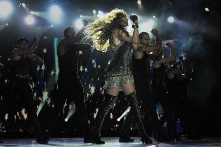 Jennifer Lopez performed a medley of her biggest hits while wearing a metallic fringed Roberto Cavalli mini dress with gold, silver and black all-over Swarovski embroidery. Her 6-8 backup dancers wore Just Cavalli costumes.