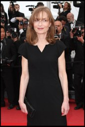 Isabelle Huppert carries a Swarovski bag