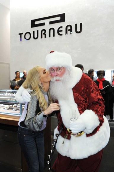 Kristin Chenoweth shares a kiss with Santa