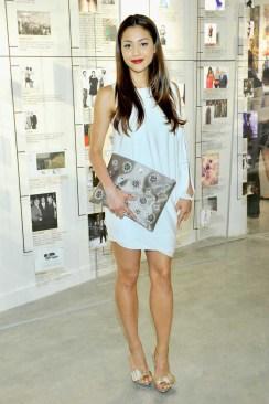 "Lindsay Morgan wears: BCBGMAXAZRIA ""Michaela One-Shoulder Knotted Sleeve Shirt"" (UZA62A02); BCBGMAXAZRIA ""Lavi Shoes""; BCBGMAXAZRIA ""Amelie Flower Jeweled Clutch"" (BDH619ES)"