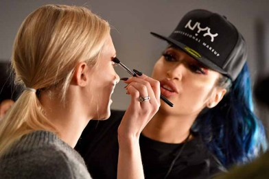 NEW YORK, NY - FEBRUARY 14: A stylist prepares a model backstage for Marcel Ostertag during New York Fashion Week: The Shows at Gallery II at Spring Studios on February 14, 2018 in New York City. (Photo by Dia Dipasupil/Getty Images for Marcel Ostertag)
