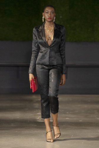 HOUSTON, TEXAS - SEPTEMBER 13: A model walks the runway wearing Negris LeBrum NYFW SS 2021 on September 13, 2020 in Houston, Texas. (Photo by Bob Levey/Getty Images for Negris LeBrum)