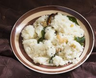 close up view of rava upma recipe in a plate