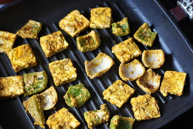 placing the paneer on a grill pan