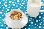 1 minute chocolate chip cookie in a cup served with a glass of milk
