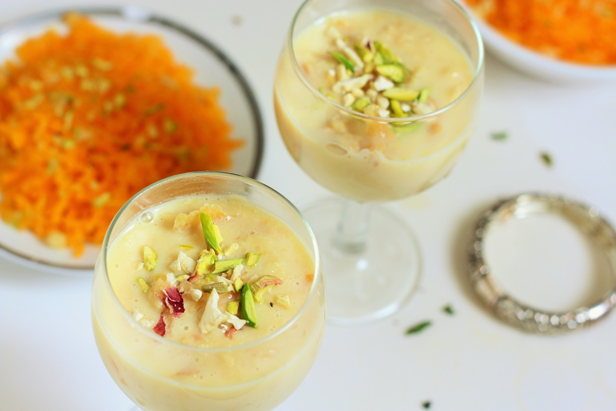 rabdi recipe garnished with nuts and served in glasses