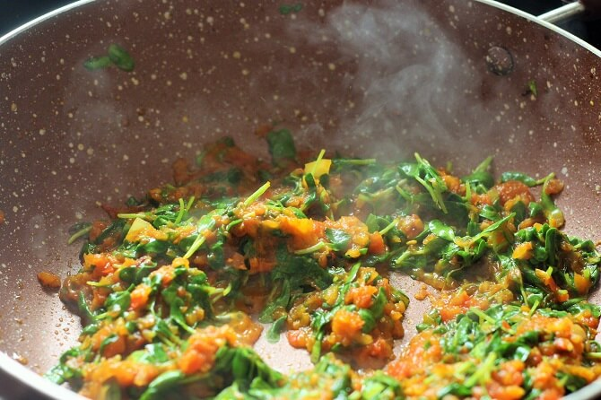 cooking methi leaves with masala