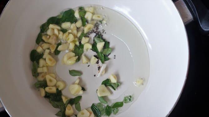 tempering done in white pan for tomato rasam recipe