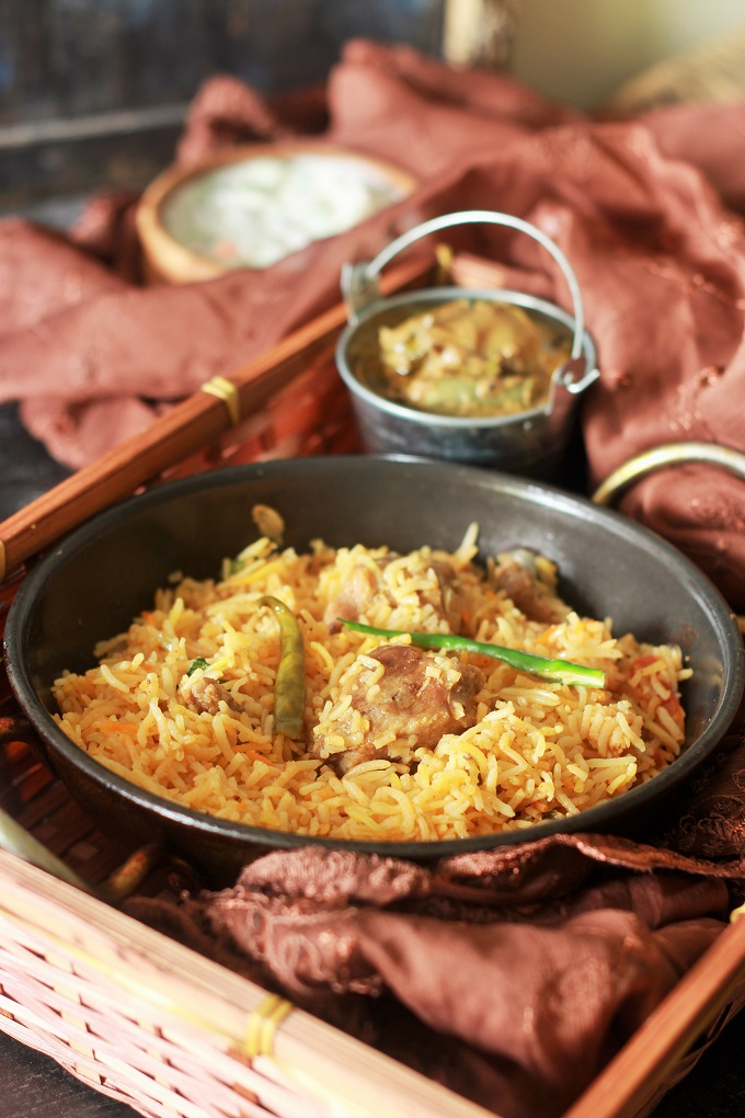 Lucknowi Mutton Biryani Recipe or the Awadhi Biryani. An absolutely delicious recipe cooked with flavorful spices in Dum Pukht method