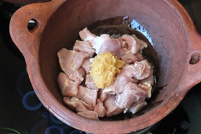 cooking mutton with ginger garlic in clay kadai