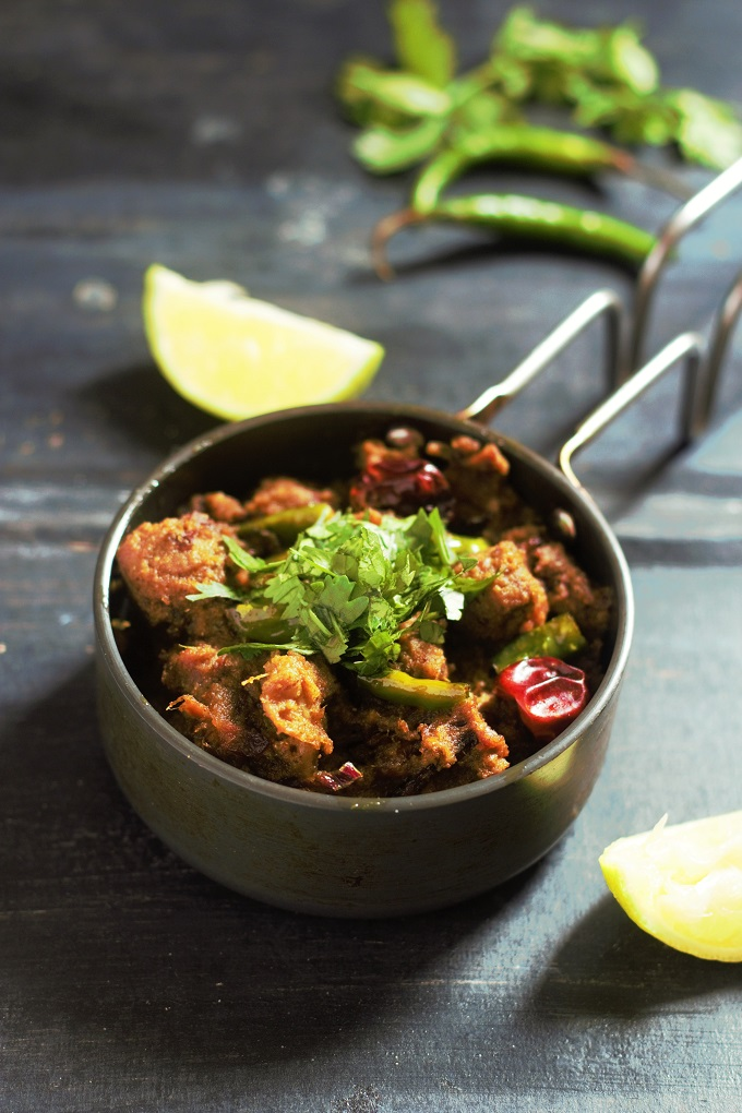 Mutton Sukka Recipe served in a small pan garnished with coriander leaves