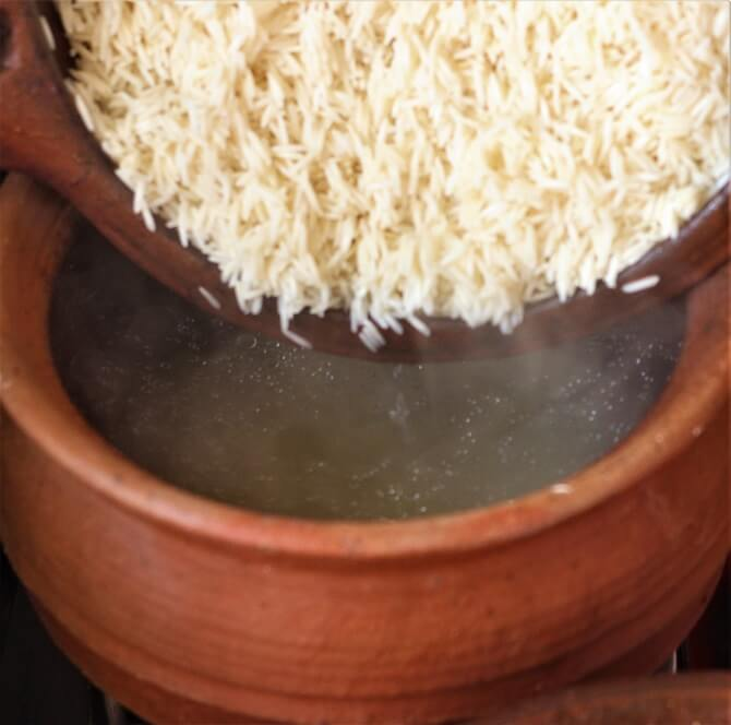 rice in boiling water for making biryani