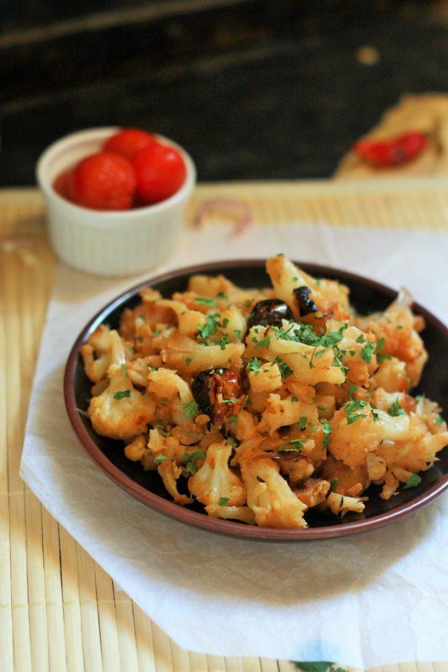 cauliflower poriyal recipe in a black plate