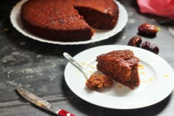 Dates Cake recipe, how to make simple dates cake. Jammed with dates, this cake will be a delight to bake. This recipes calls for boiling the dates before mixing in. And small chunks of cut dates gives that crunchy flavor that will leave you asking for more.