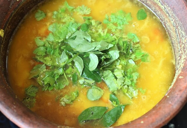 coriander leaves, curry leaves added to boiled dal