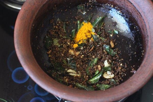 turmeric powder and salt added to milagu rasam