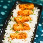 paneer fry placed on cooked rice in a long plate
