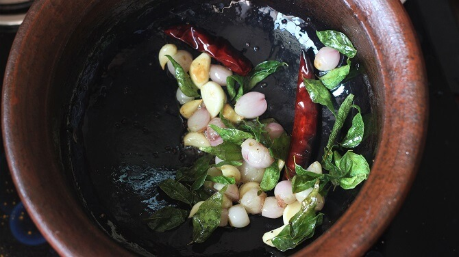 onion and tadka in a clay pot