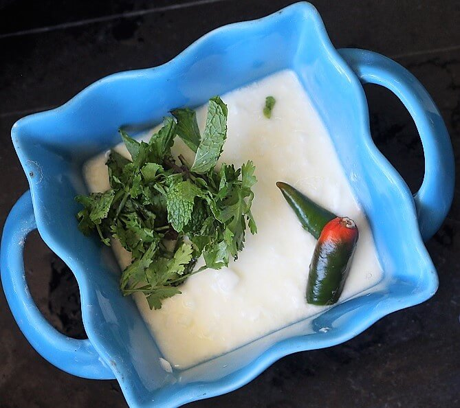 herbs and green chili in yogurt