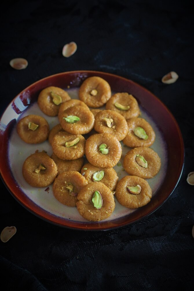 instant kesar peda recipe garnished with pistachio in a plate
