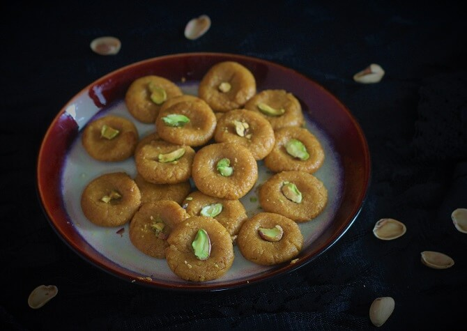 kesar peda recipe with pista in a plate
