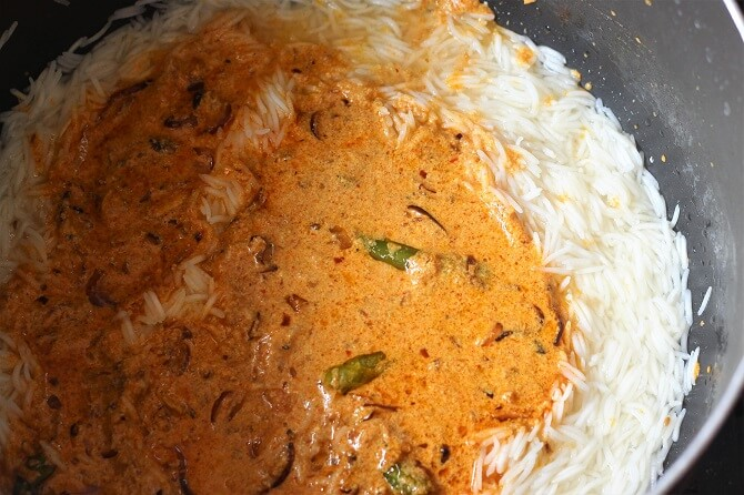 egg dum biryani masala added over cooked rice