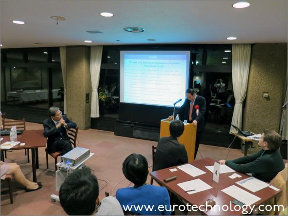 Masamoto Yashiro (right hand side) presenting and President of Tokyo University Junichi Hamada (sitting on the left) listening
