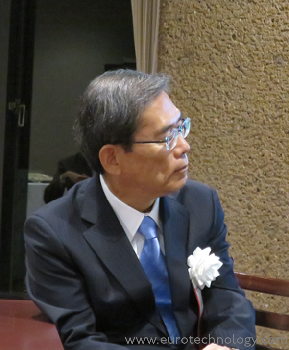 Professor Junichi Hamada, President of The University of Tokyo, listening to Masamoto Yashiro's talk