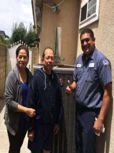Frank with a happy customer after hvac installation in the