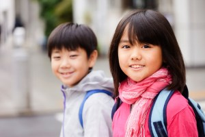 image showing ta boy and a girl with backpacks