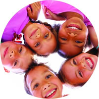 image showing five young smiling faces