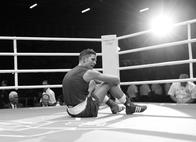 France's Alexis Vastine sits on the canvas after becoming upset with the decision giving the Men's Welter (69kg) quarter-final boxing match to Ukraine's Taras Shelestyuk at the London Olympic Games