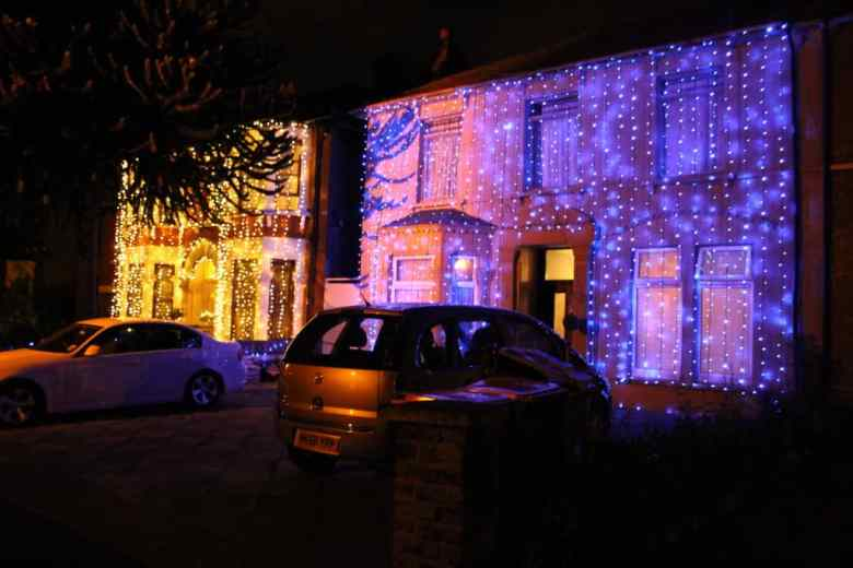 My house with the yellow lights and next-door, my husband's house in the blue lights