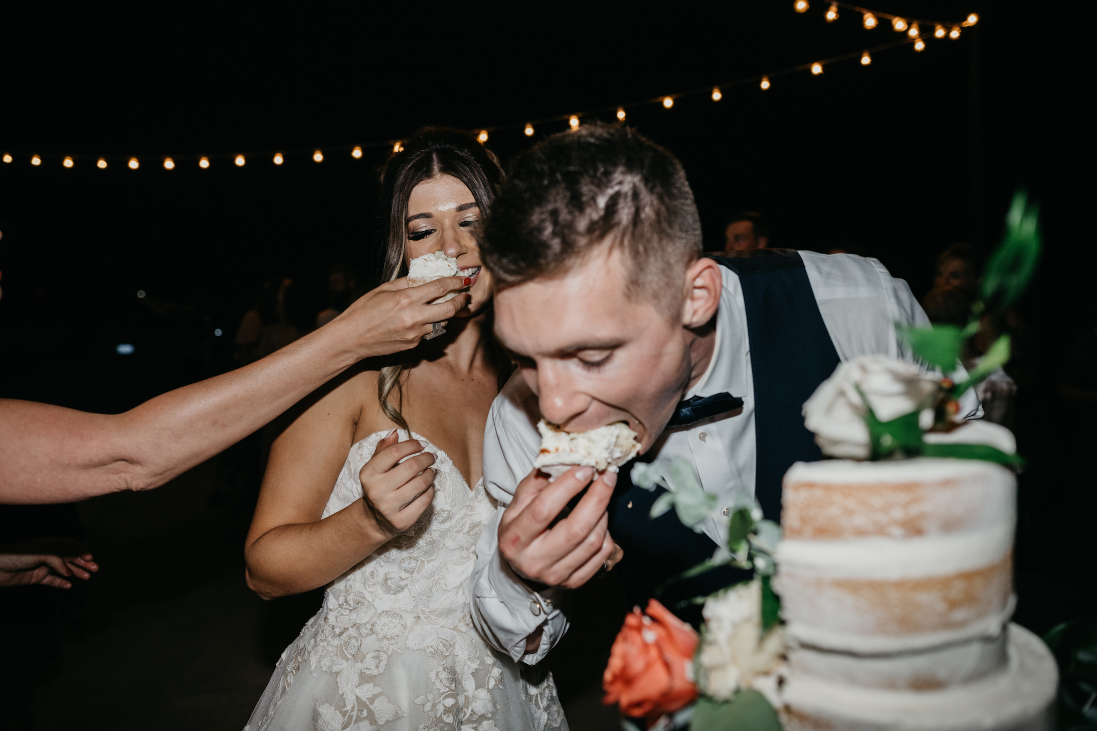 Bride and Groom eat cake, image by Fatima Elreda Photo