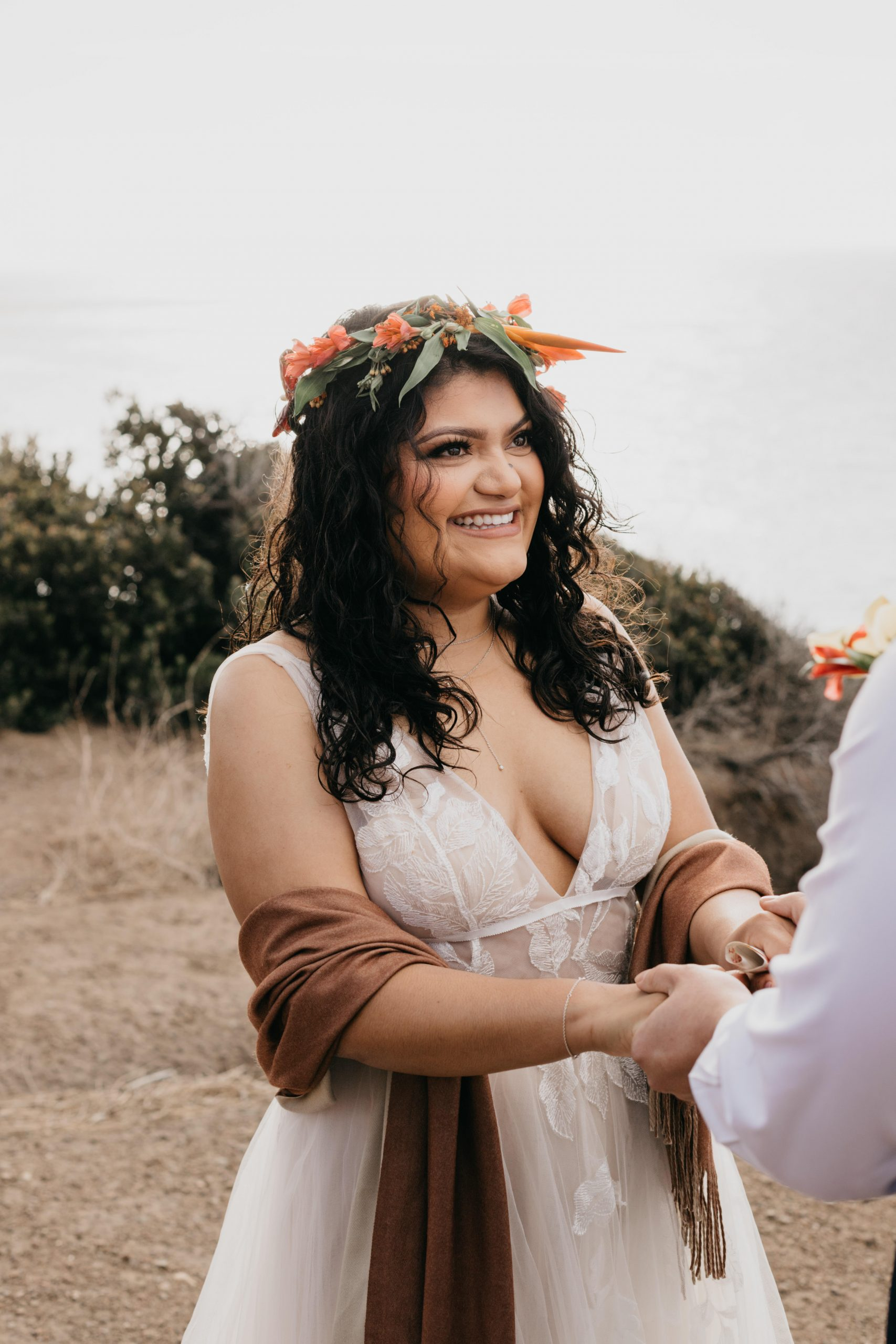 Bride looking at her husband during elopement ceremony, image by Fatima Elreda Photo