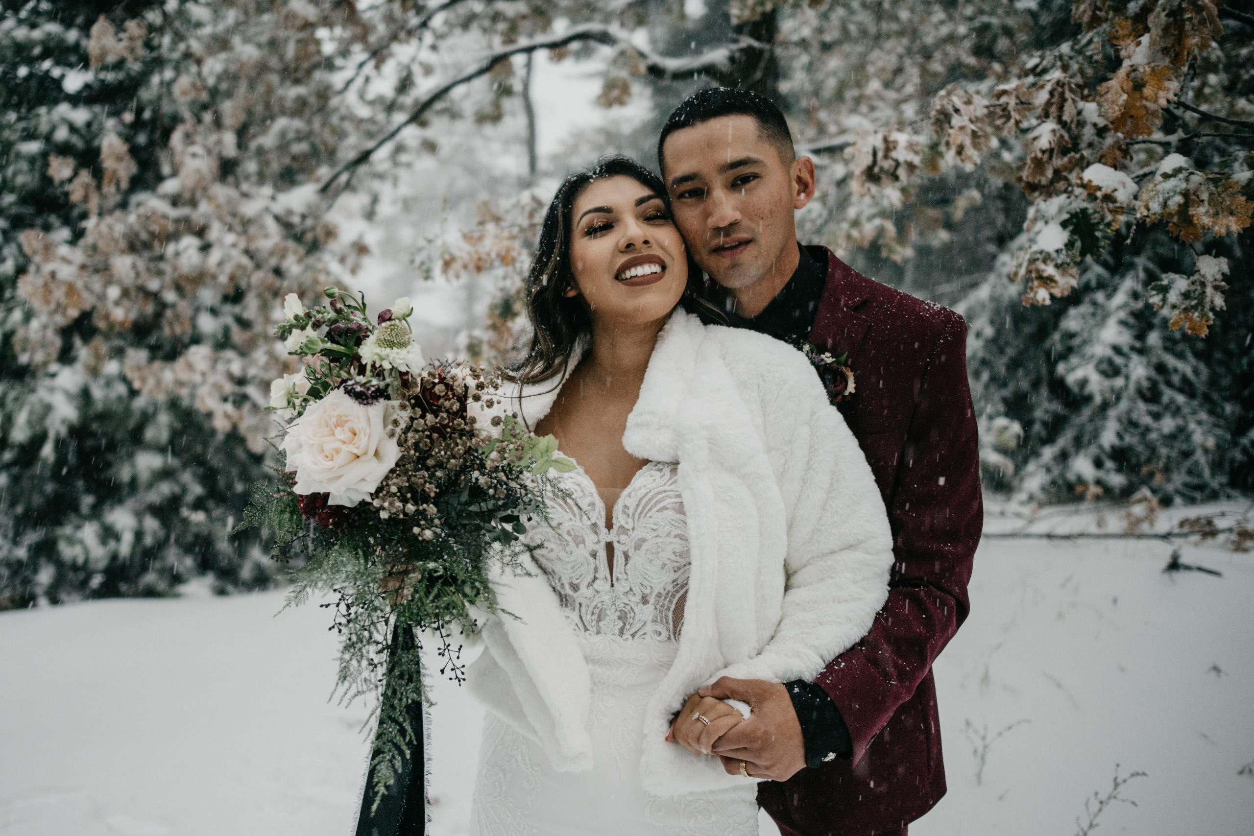 Bride and Groom portraits in the snow, image by Fatima Elreda Photo