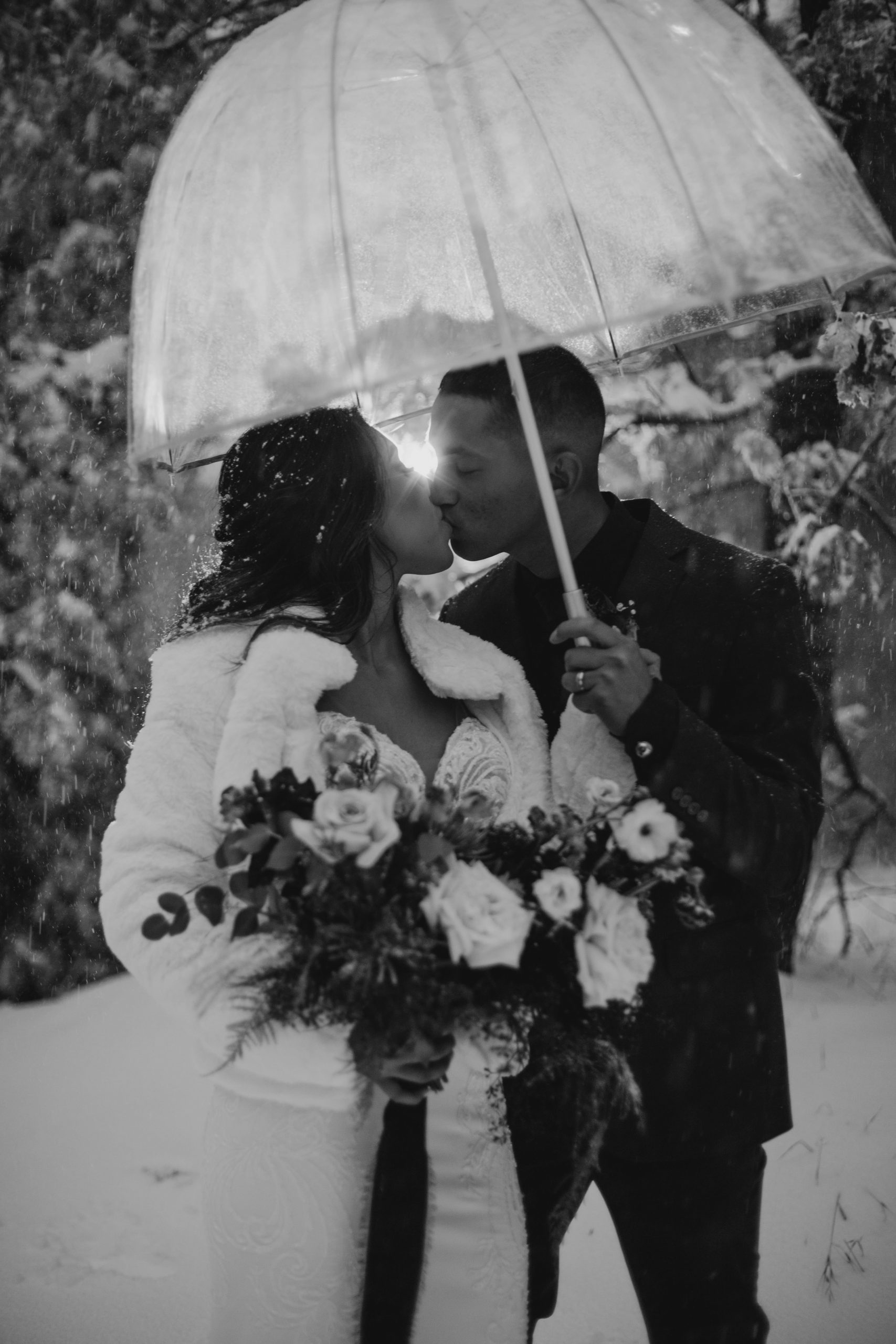 Bride and Groom portraits in the snow in Arrowhead Pine Rose Cabins, image by Fatima Elreda Photo