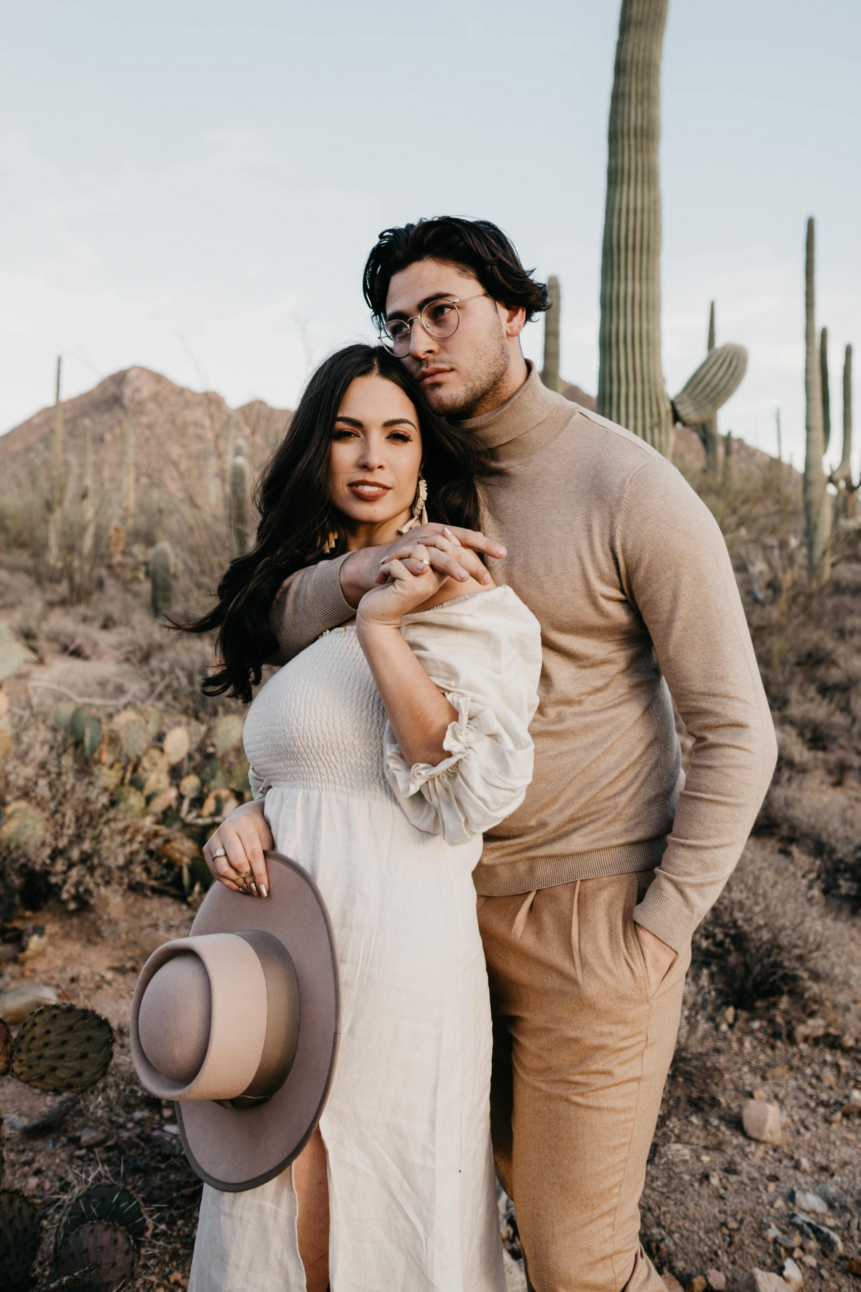 Couple posing for camera in the desert, image by Fatima Elreda Photo