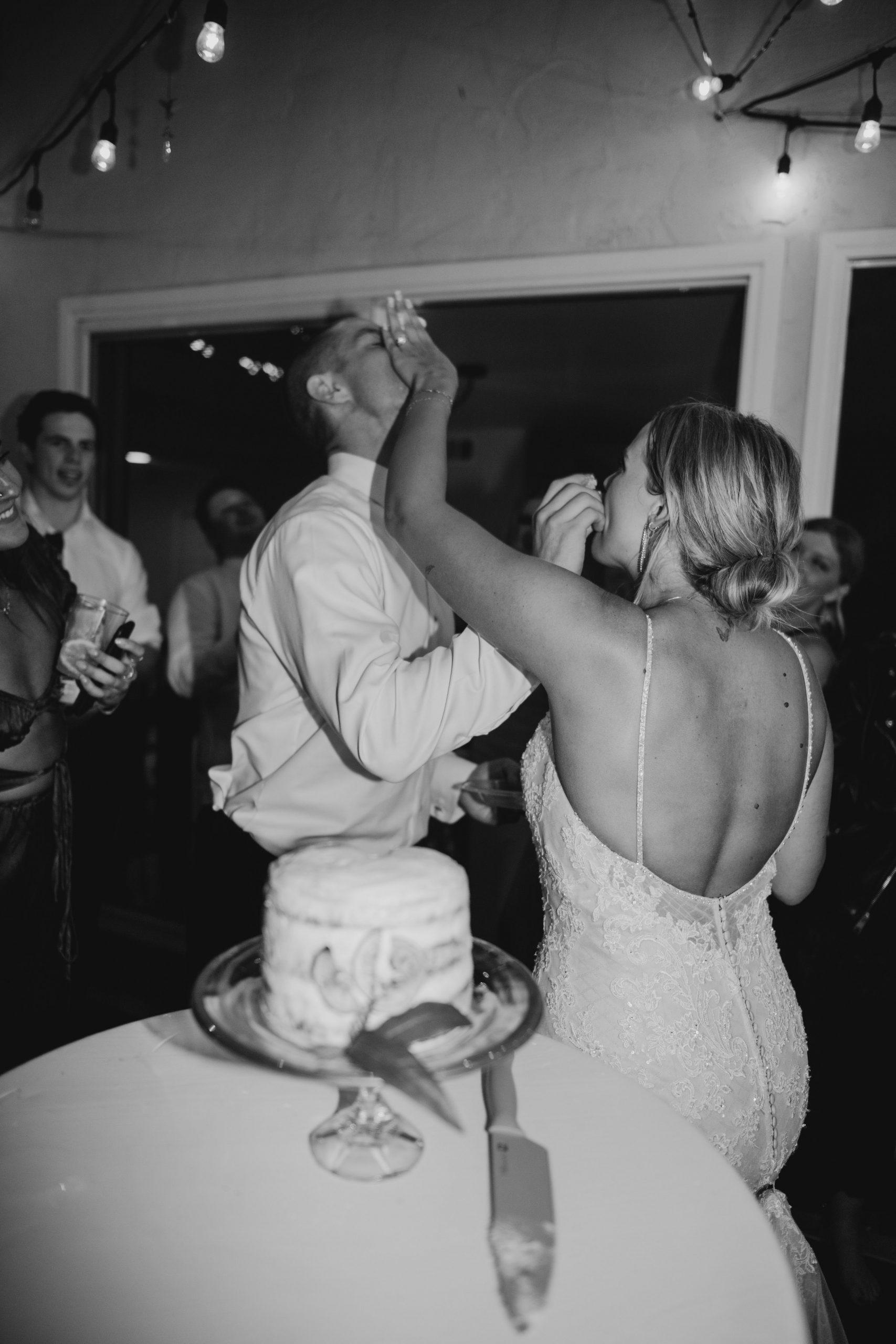 Bride and groom cut cake in Bouquet toss in Laguna Beach Backyard Wedding, image by Fatima Elreda Photo