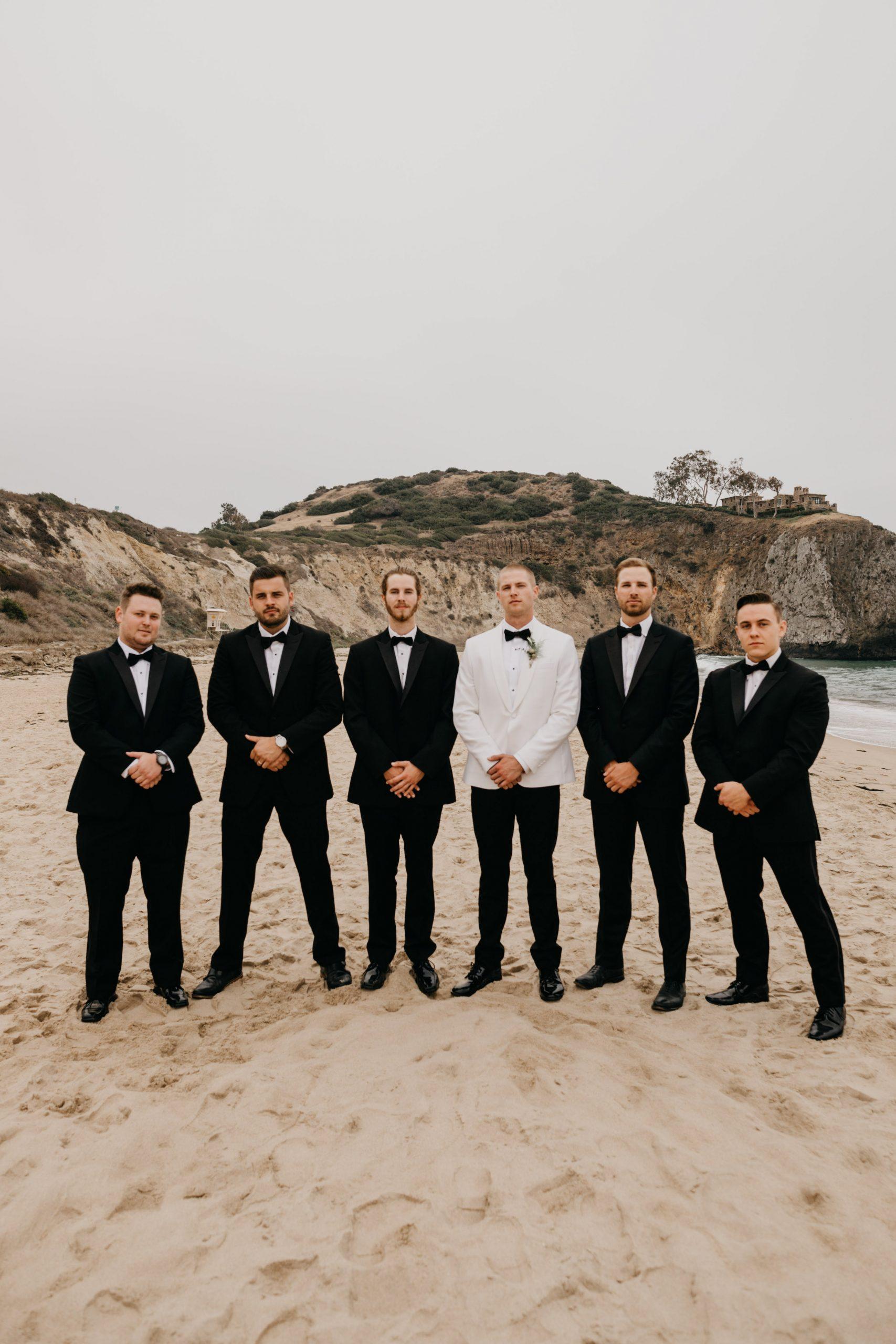 Groom and groomsmen in Crystal Cove State Park Wedding in Laguna beach, image by Fatima Elreda Photo