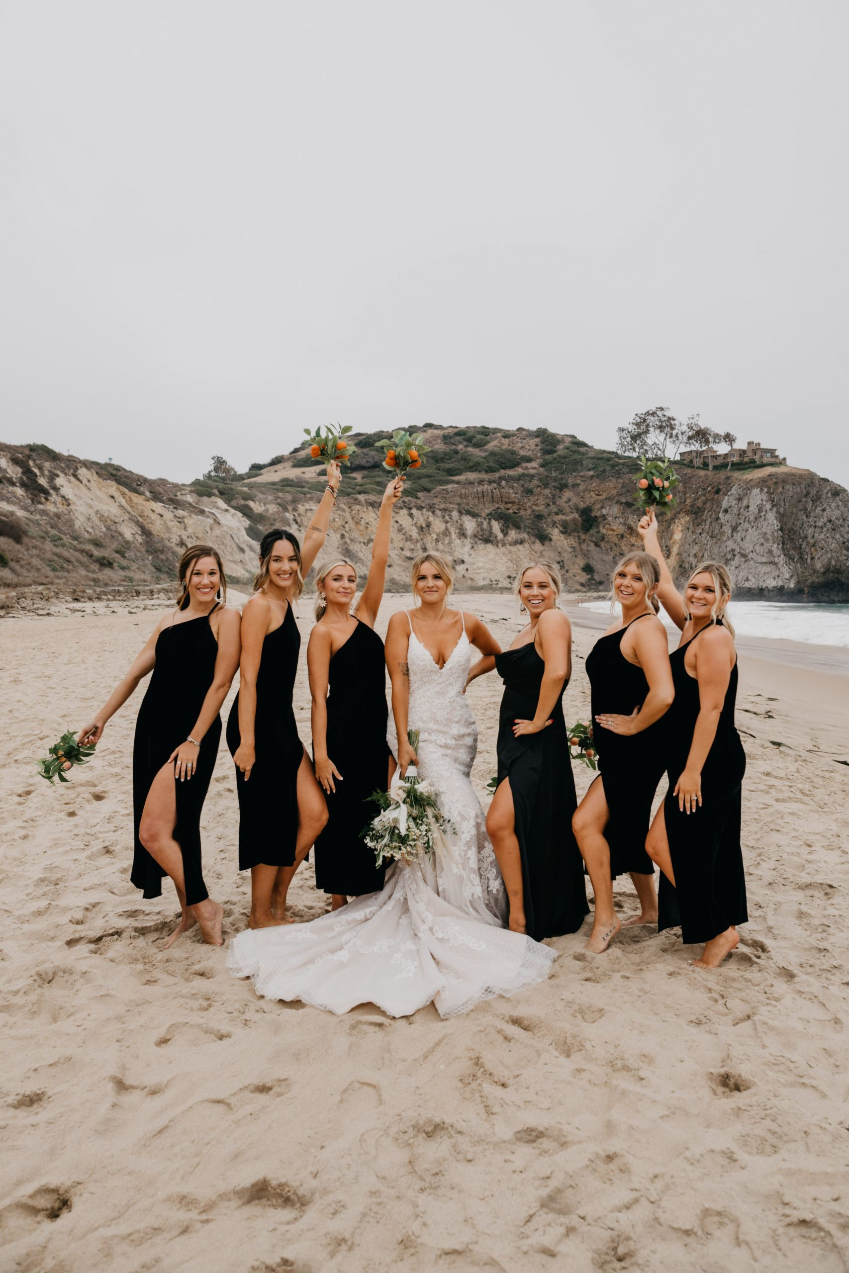 Bride and bridesmaids in Crystal Cove State Park Wedding in Laguna beach, image by Fatima Elreda Photo