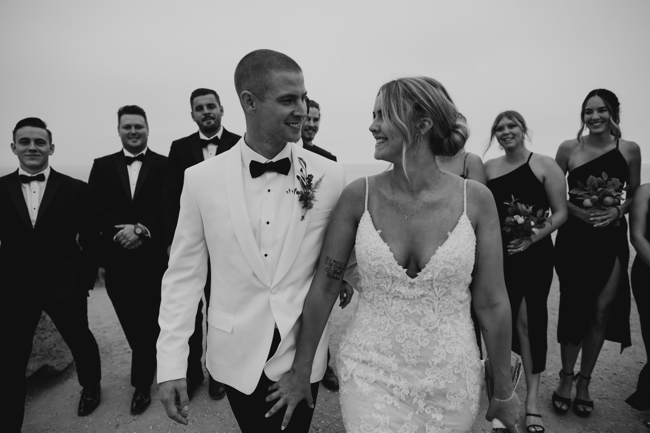 Black and white photo of bridal party in Crystal Cove State Park Wedding in Laguna Beach, image by Fatima Elreda Photo