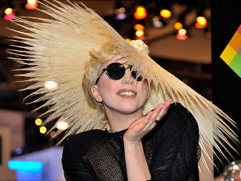 LAS VEGAS - JANUARY 07:  Singer Lady Gaga during an announcement of Lady Gaga's long term partnership with Polaroid as the brand's creative director on a speciality line of imaging products at the 2010 International Consumer Electronics Show at the Las Vegas Convention Center January 7, 2010 in Las Vegas, Nevada. CES, the world's largest annual consumer technology tradeshow, runs through January 10 and is expected to feature 2,500 exhibitors showing off their latest products and services to about 110,000 attendees.  (Photo by David Becker/Getty Images)   Original Filename: GYI0059240757.jpg
