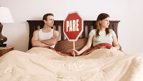 Couple_holding_stop_sign_in_bed