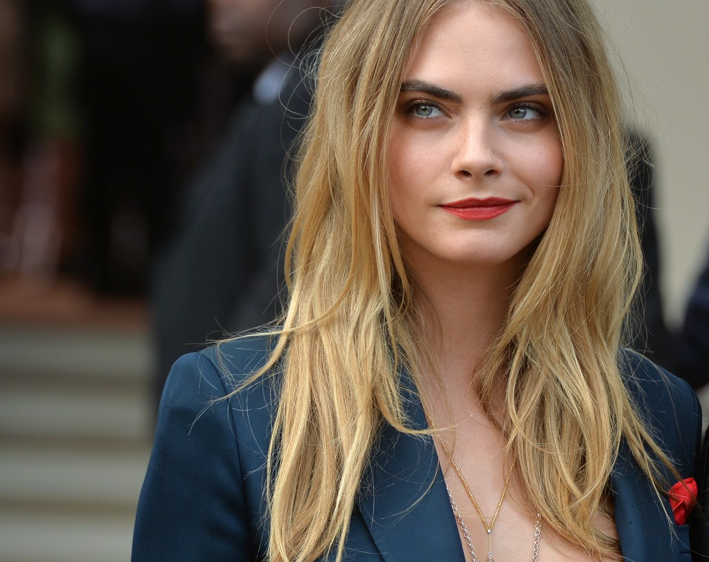 LONDON, ENGLAND - SEPTEMBER 15: Cara Delevingne attends the Burberry Prorsum show Womens wear 2015 during the London Fashion Weekk SS15 on September 15, 2014 in London, England. (Photo by Anthony Harvey/GettyImages)