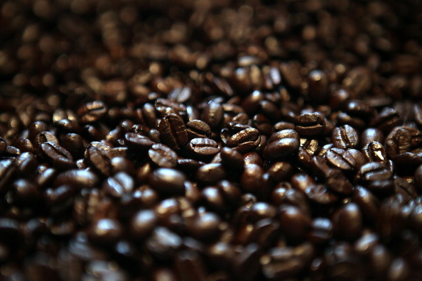 SAN FRANCISCO, CA - AUGUST 26: Freshly roasted coffee beans are sit in a bin at Graffeo Coffee on August 26, 2011 in San Francisco, California. Coffee shops across the country are being faced with the decision to raise retail coffee prices as wholesale coffee bean prices are surging. According to the International Coffee Organization, the daily average composite price of coffee beans has gone up nearly every day over the last 12 days. (Photo by Justin Sullivan/Getty Images)